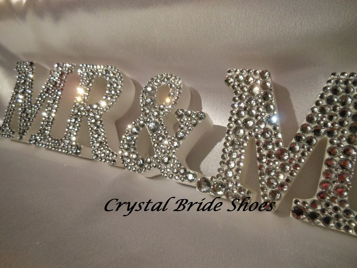 White Wooden Mr & Mrs Sign customised with clear crystal diamontes. £30.00, via Etsy.