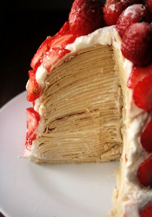Amazing Amy. Crepe cake with cream. Powdered sugar and berries.