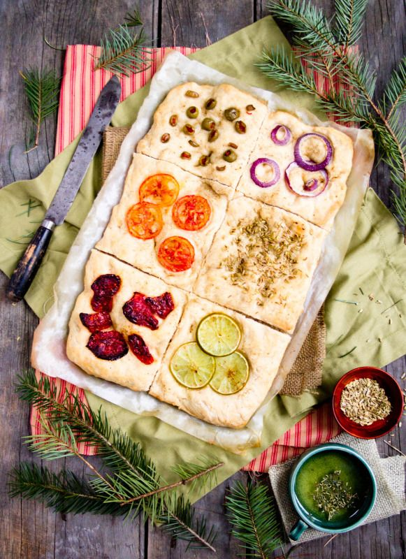 No-knead Focaccia tiles. Topped with lime, roma tomatoes, sun dried tomatoes, fennel seeds, olives and red onion.