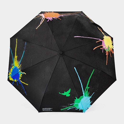 Color-Changing Umbrella: The collapsible Color-Changing Umbrella transforms into a walking piece of art when used in the rain. The designers incorporated unique color-changing technology, so the splatter pattern on the Color-Changing Umbrella's exterior changes from white to bright shades of green, yellow, blue, pink, and orange when wet. As it dries, the umbrella's pattern returns to white.: Changing Umbrella Starts, Umbrella Changes Colors, Color Changing Umbrella, Awesome Gadgets, Color Changing Technology, Awesome Things, Colors Appear, Awesome Stuff, Awesome Inventions Gadgets
