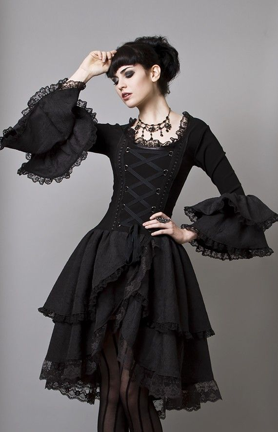 Lovely corset based dress and the lace sleeves, length of skirt and cross laces on the bodice... yummy!