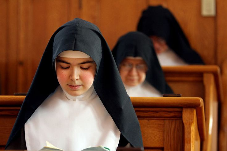 Sister Faustina kneels while praying the Divine Office ...