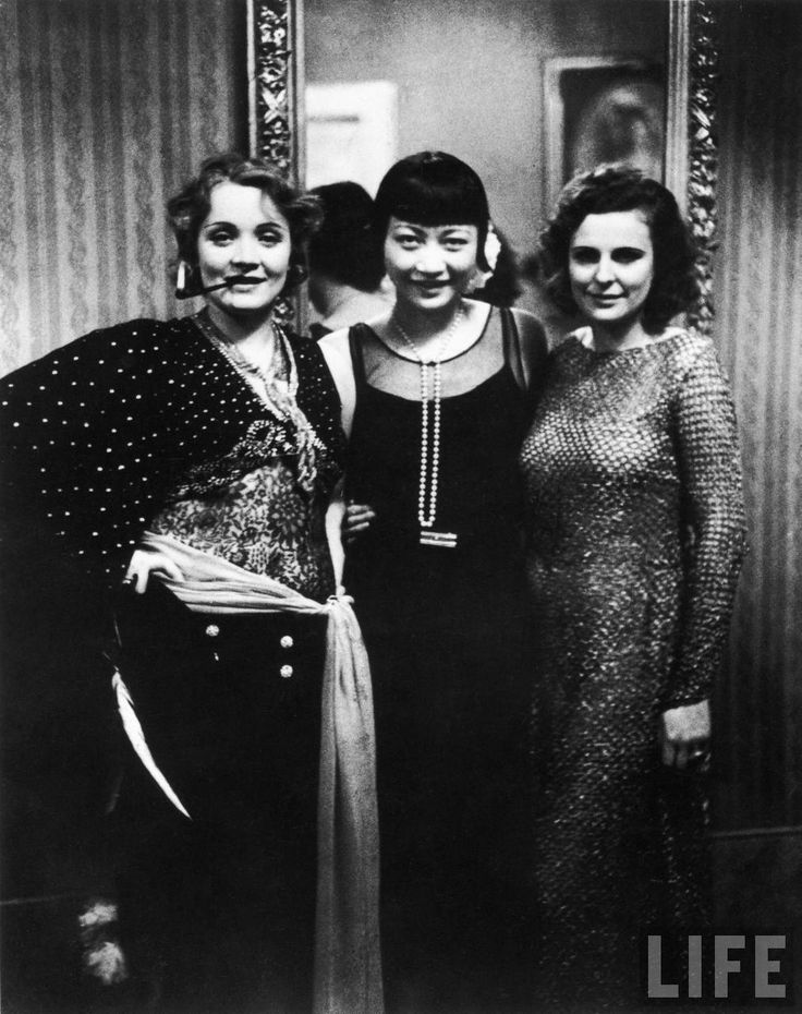 Actresses Marlene Dietrich and Anna May Wong with filmmaker Leni Riefenstahl at Pierre Ball    Berlin, 1928  Photograph by Alfred Eisenstaedt