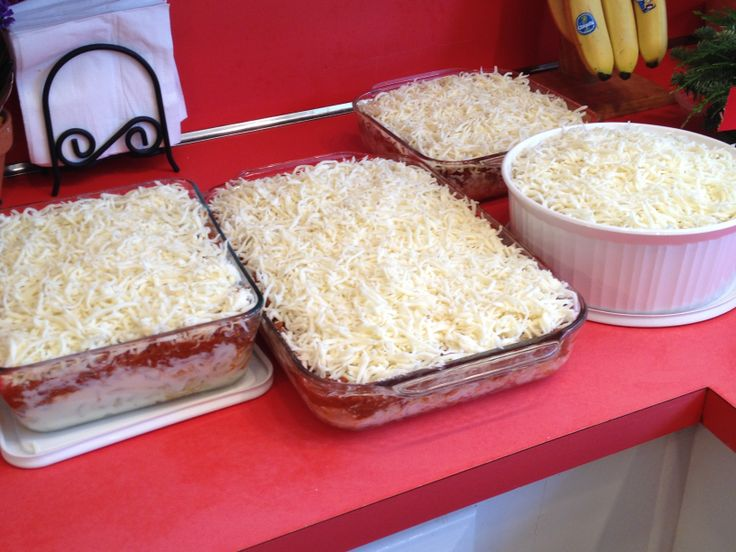4 spaghetti/elbow noodle casseroles:  4 lb ground beef, 2 small onions, 3 @ 24 oz jars DelGrosso pasta sauce,  2 lb elbow noodles, 40 oz ricotta mixed w 4 eggs (the ricotta was 3 lbs but I had removed a cup already), generous sprinkling of Parmesan, 3 lbs (2@24 oz pkgs) shredded mozzarella With these quantities you could mix the noodles in w the ricotta/egg mixture before spreading into greased pans.