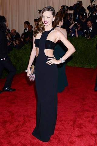 Miranda Kerr was dressed by Michael Kors in a black cut-away dress and carried a spiked Christian Louboutin clutch