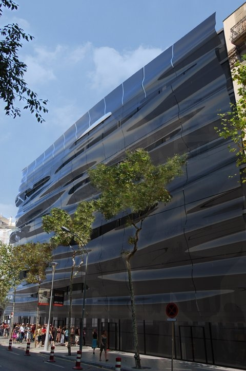 The h2o building in Barcelona. They are a bottled water company and had a facade retrofit. The concept for the new facade is based on the interference patterns that are created by the flow of water surfaces.