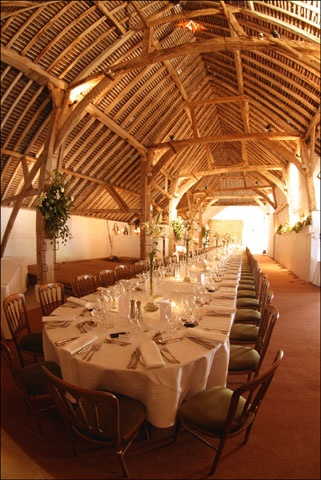 The Main Barn set with a single large table for 80 people for lunch Pangdean Sussex