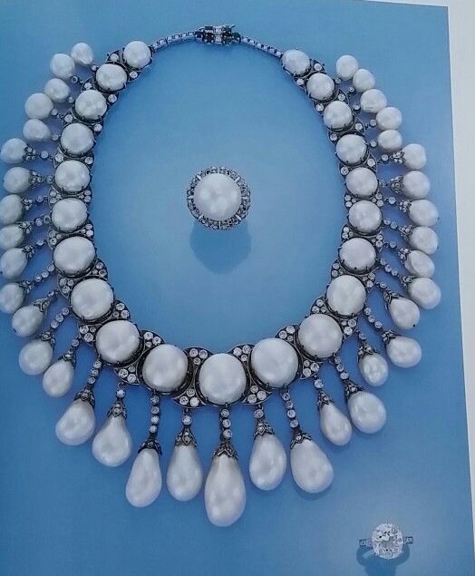 BAROQUE PEARL AND DIAMOND NECKLACE~ from Important Jewels - Christie's New York - December 10, 1991 - a baroque pearl and diamond necklace, cultured pearl and diamond ring.: