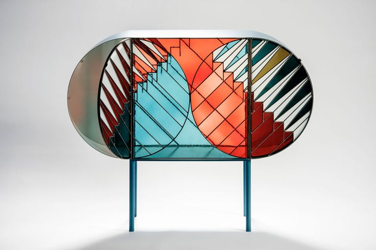 """Designer Patricia Urquiola collaborated with graphic designer Federico Pepe to creat a striking capsule collection for Spazio Pontaccio. Inspired by its name – 'Credenza' – which in Italian, means both cupboard and one's belief, the line reinterprets religious stained glass through its application to modern day design."""
