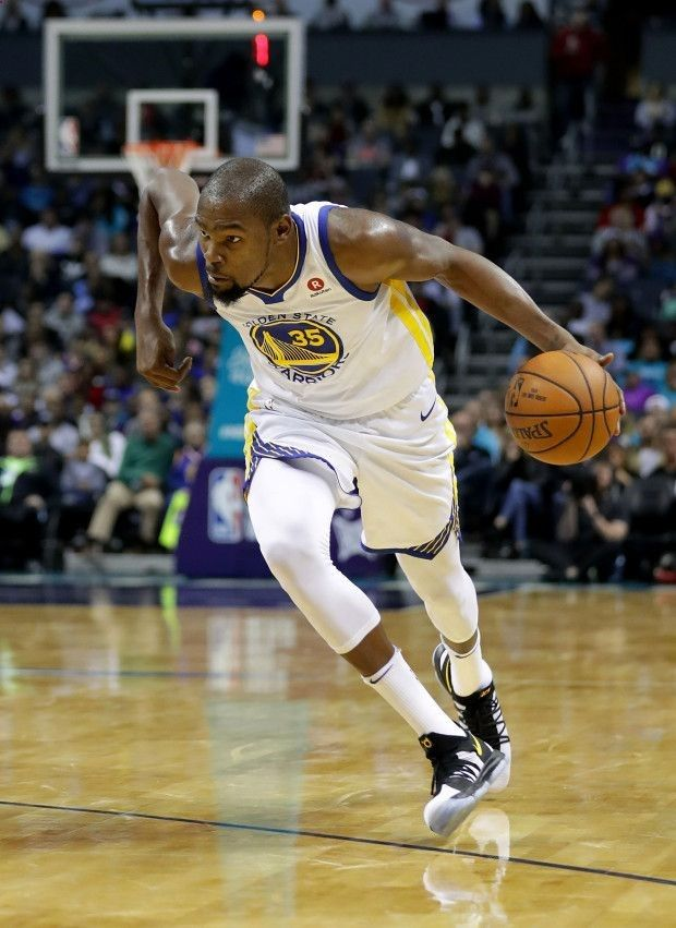 Academy of Scoring Basketball - CHARLOTTE, NC - DECEMBER 06: Kevin Durant #35 of the Golden State Warriors brings the ball up the court against the Charlotte Hornets during their game at Spectrum Center on December 6, 2017 in Charlotte, North Carolina. NOTE TO USER: User expressly acknowledges and agrees that, by downloading and or using this photograph, User is consenting to the terms and conditions of the Getty Images License Agreement. (Photo by Streeter Lecka/Getty Images) TSA Is a...