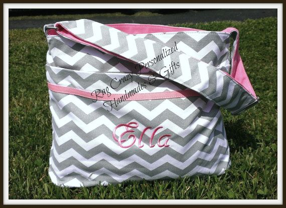 What a great Mommy gift. This is our gray and white canvas chevron print diaper bag with Gray or Pink trim and adjustable carrying strap. Inside lining
