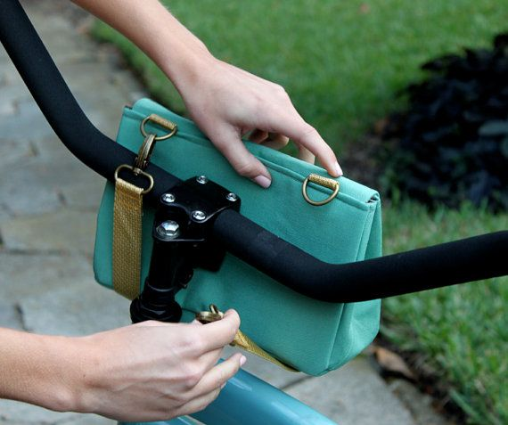 Hand made bicycle handlebar bag.  Converts to a wristlet and has built-in card holder.  Want!