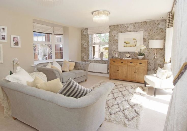 David Wilson Homes - Layton at The Chestnuts, Barkby Road, Syston, Leicester  Elegant living room with rounded sofas.