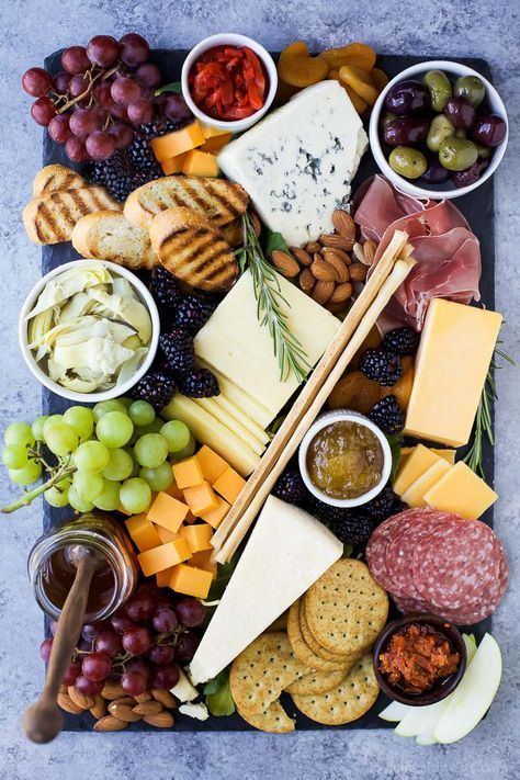 How to Make the Ultimate Cheese Board and which wines to pair it with! This appetizer recipe is easy to make and definitely a show stopper!   #ad #UndeniablyDairy