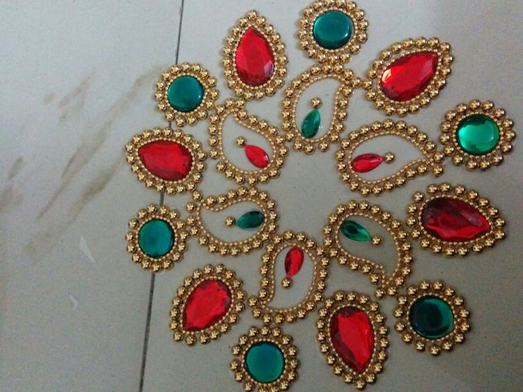 Golden,red and green kundan rangoli