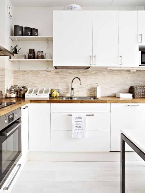 Wood-Top Counters, White modern cabinetry, some exposed shelving