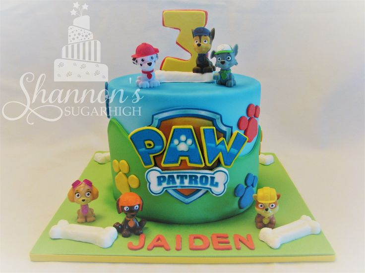 Fondant covered round PAW Patrol cake with toy figurines that the birthday boy can keep! Vanilla cake with chocolate buttercream filling and chocolate ganache frosting. Keywords: dog, bone, Marshall, Rocky, Chase, Rubble, Zuma, Skye.