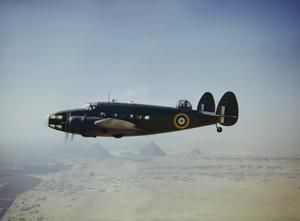 A Royal Air Force Lockheed Hudson Mk VI (AE626) of the Middle East Communications Flight flying over the Egyptian pyramids, 1942.