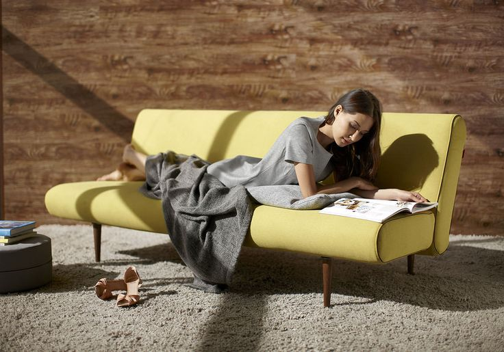 A multifunctional sofa bed with a unique design for sitting, sleeping and napping.