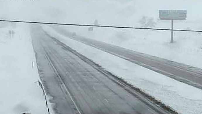 Snow covers the ground off Interstate 90 east of Sturgis, South Dakota, United States, in this view from a highway camera taken May 10, 2015.