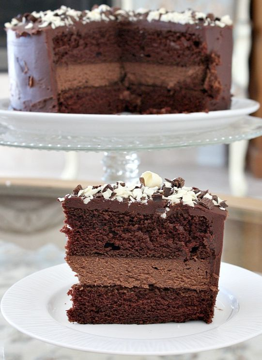 Chocolate Cheesecake Cake : a layer of chocolate cheesecake sandwiched in-between two layers of rich chocolate cake. Covered with chocolate frosting and garnished with chocolate shavings