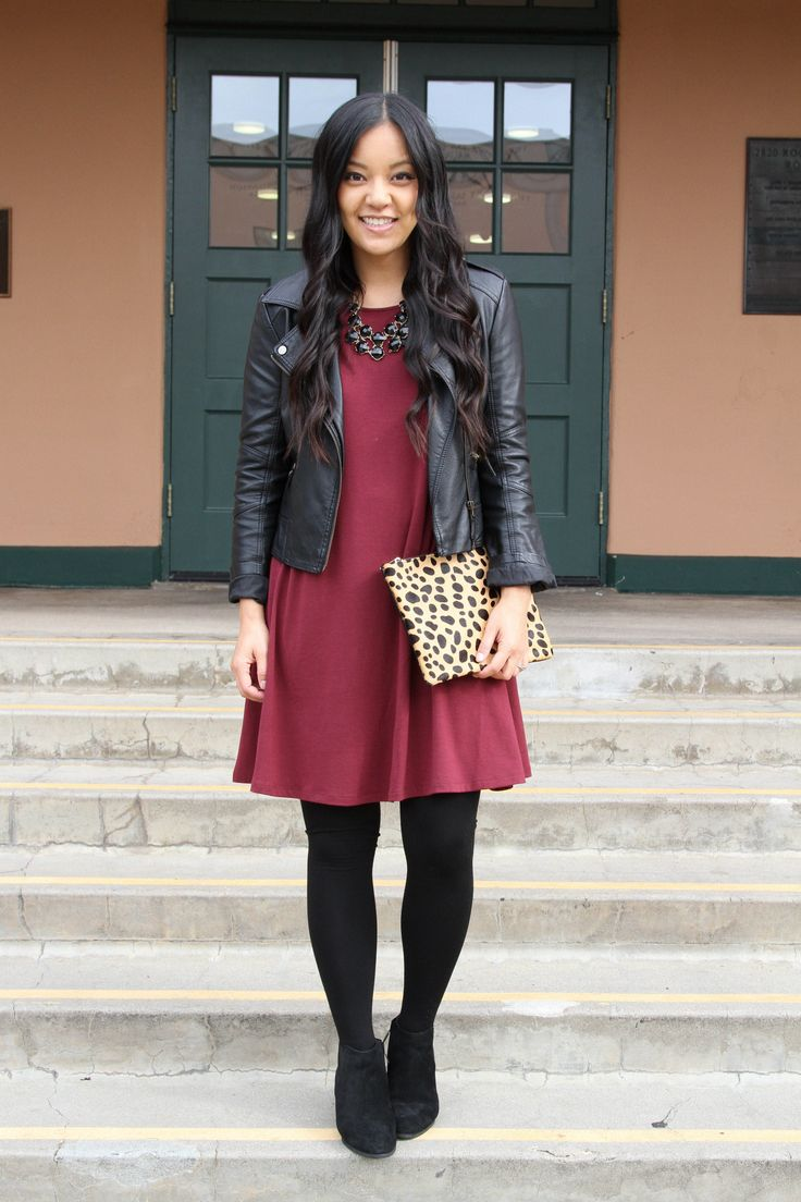 Dressy Casual Holiday Outfit Ideas: Black Moto Jacket + Maroon Swing Dress + Leopard Clutch + Black Booties