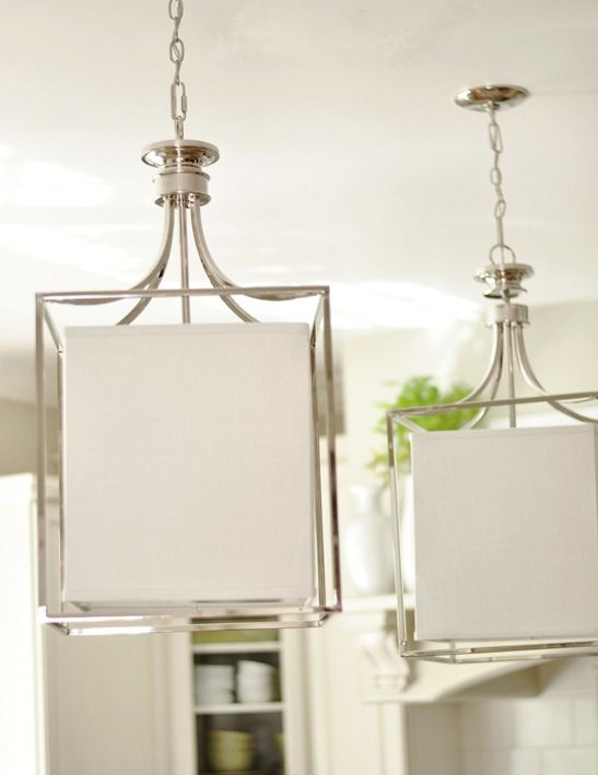 Love these polished nickel lights from Capital Lighting over an island!