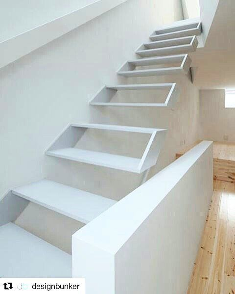 Tamatsu House by Kenji Ido with a stair design that appears like an isosceles trapezium  .