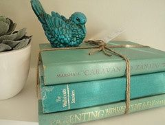Stacks of vintage books in the rich colors wrapped with twine or ribbon