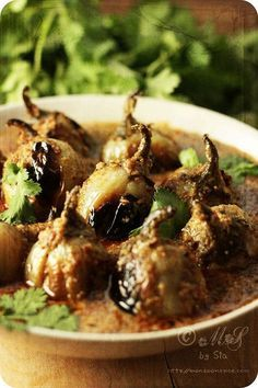 Stuffed Baby Eggplants in mildly spiced peanut and coconut gravy  by Sia Krishna