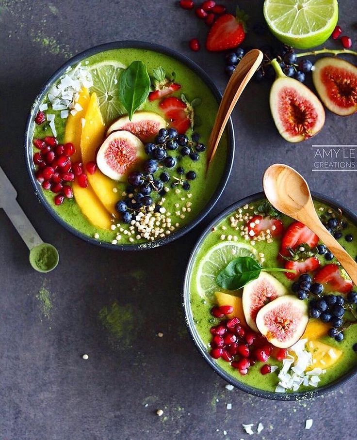 Green smoothie bowls by @amylecreations Makes the 2 small bowls above: Blend: 2 cups coconut water 2 cups baby spinach 2 small frozen bananas 1/2 cup mango 1 tsp flaxseed flour 2 tsp super greens mix which includes wheatgrass barley grass moringa baobab spirulina & chlorella Topped with pretty much a fruit salad;) #bestofvegan