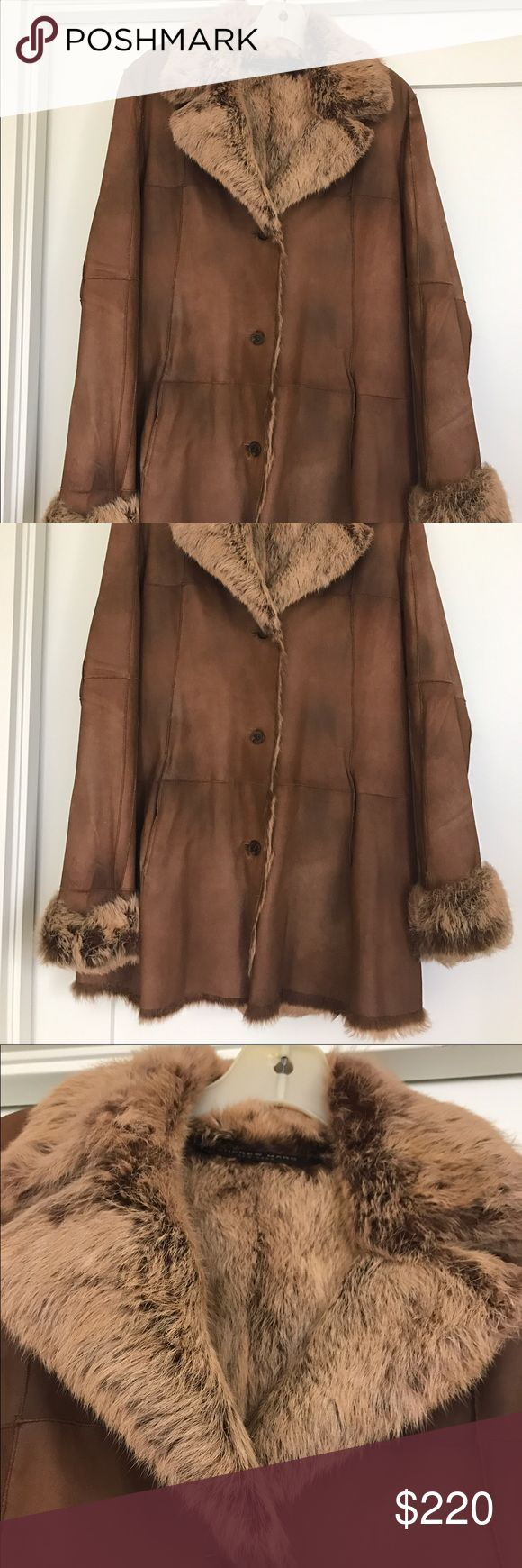 Andrew Marc Fur/Leather Coat Lucious Andrew Marc leather coat with long-coat rabbit lining, cuffs and collar! It is in excellent condition except for one small spot on the back (see photo). Retailed for $569!!!! Andrew Marc Jackets & Coats