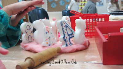 Children love making birthday cakes with play dough. Adding number candles as a prop like this can help strengthen numeral recognition.