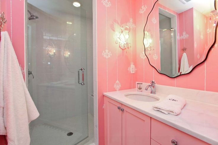 Love the shade of pink and the white chandelier stencils on the wall!