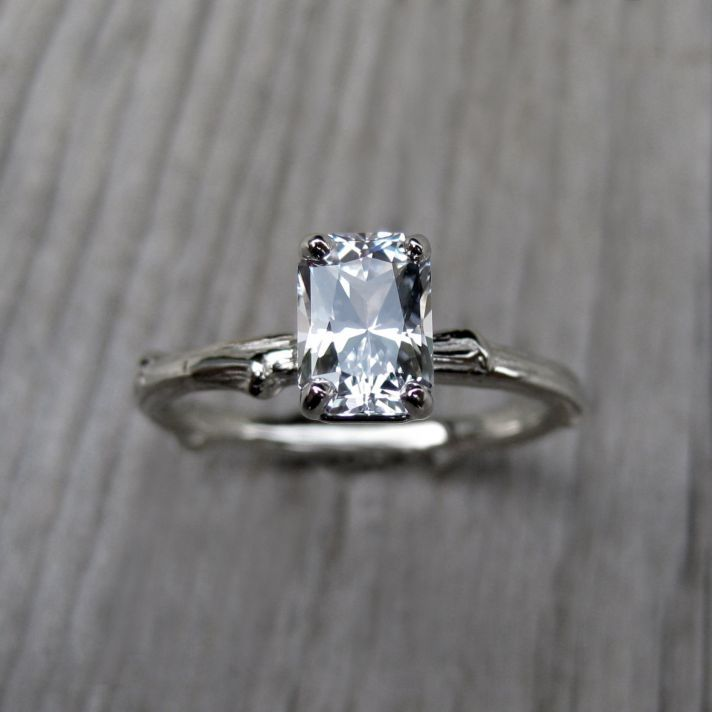 Made by Kristen Coffin.  I like the rustic feel of this ring, although I feel the gemstone is too big.  Non traditional, but gorgeous.