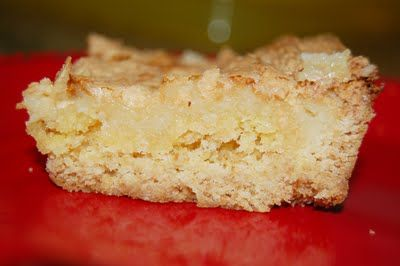 "Texas Gold Bar  1 pkg yellow cake mix  1 egg  1 stick margarine, softened (1 Cup)  1 8oz pkg cream cheese, softened  2 eggs  1 box powdered sugar  350º. Combine first three ingredients and press into 8 1/2 x 11"" ungreased pan, and up the sides about an inch.  Mix together cream cheese, eggs, and powdered sugar and pour over crust. Bake 45 minutes or until golden brown"