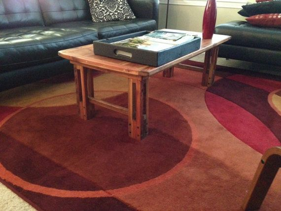 Handcrafted coffee table from 100 reclaimed heart pine by SaltWood, $425.00