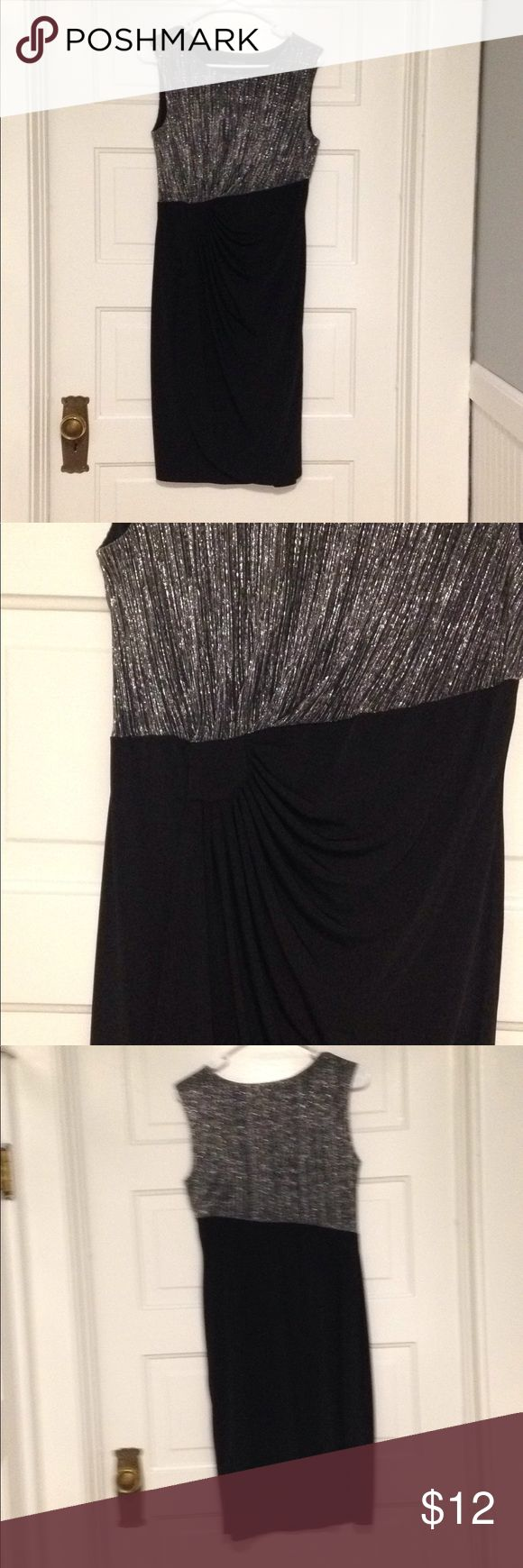 Dress Cute little dress that might be fun for a holiday party. Silver and a little gold for upper body   At waist, is a little gather that kind of looks like a sunburst  95%polyester 10%spandex made by enfocus petite size 10 petite enfocus petite Dresses Asymmetrical