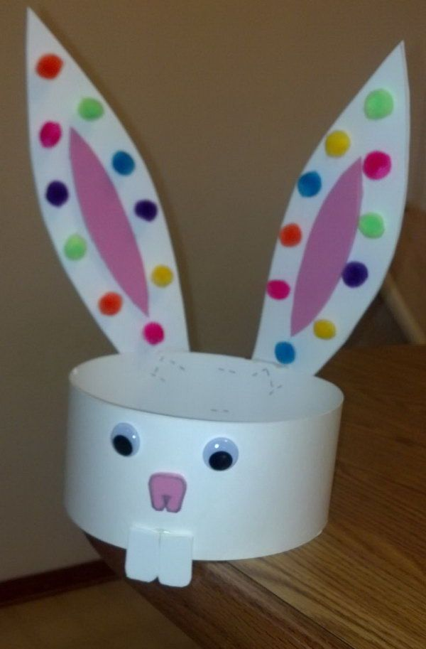 Simple Easter Hat. Make this hat with used buttons instead of pom poms. Make sure that you glue the ears on the back so they would stay straight with extra weight. Try to DIY such a simple Easter hat by yourself. It can bring your kid a lot of fun! http://hative.com/cool-easter-bonnet-or-hat-ideas/
