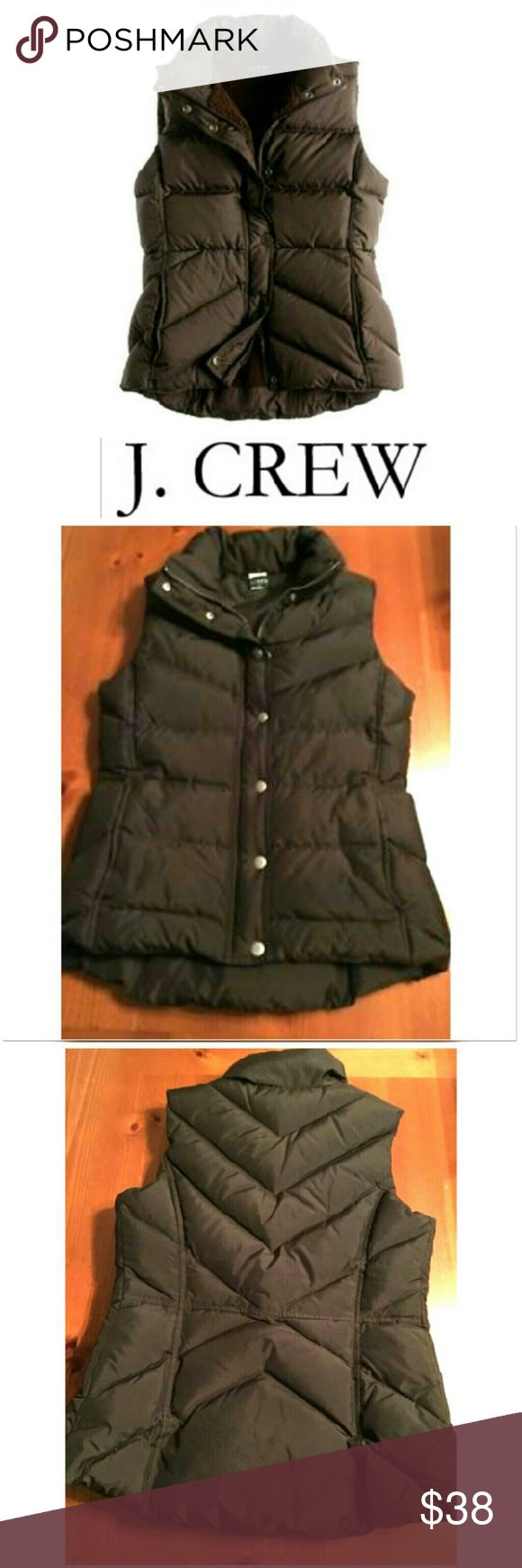 Goose Down Puffer J. CREW brown vest Thus classic J. CREW vest is perfect for keeping you stylishly warm on cold days. Chocolate brown polyester she'll with minimum of 80% down remainder waterfowl feather. Zipper and metal zipper clasps, pockets with clasps, collar for extra warmth and protection. Size Medium. In EXCELLENT CONDITION, NO DAMAGES. Dress up or down with jeans and boots, legging and long sleeves...possibilities are endless! Grab yours for way less and look sexy and warm in your…