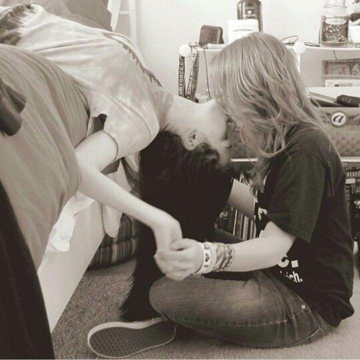Cute lesbians kissing each other