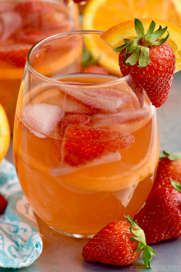 This Sunset Sangria is made with orange, strawberry, rum and will quickly become a favorite!