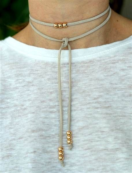 This beige suede choker necklace goes with just about any outfit thanks to its neutral color.