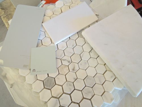 Honeycomb marble floors, subway tile shower, grey cabinets, mint walls, and marble countertops are all in the mix. SW Sea Salt paint