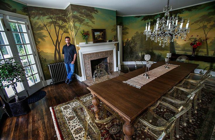 Artist Andy Eccleshall paints unique, one-of-a-kind murals, including this one extending all the way around the large formal dining room in the home of Jennifer and Donald Kaump. (Dan Bates/The Herald)
