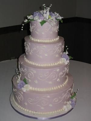 purple wedding cakes- I like the look of this cake.  I love the purple, just not sure it my colors will be purple or not.