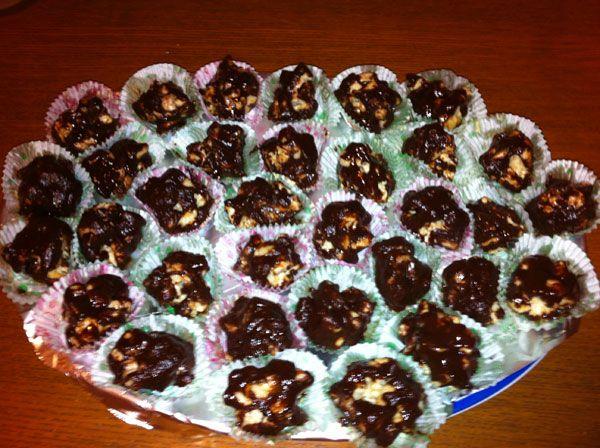 Bombons Macadâmia - Bombons Macadâmia misturam 2 tipos de chocolate com um travo de gengibre e a crocância das nozes da macadâmia.