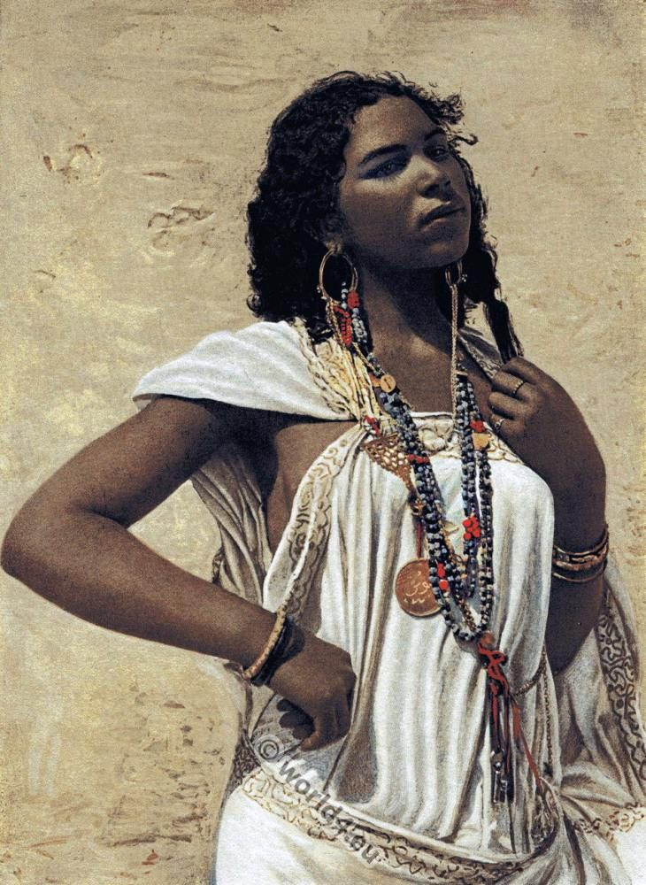 An Arabian woman in traditional clothing and jewelry. [H. N. Hutchinson, 1900]