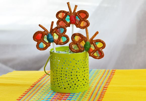 Rainbow Pretzel Butterflies using multi-colored fruit roll-ups and a heart cookie cutter and half of a fruit gusher for body glued with melted white chocolate.