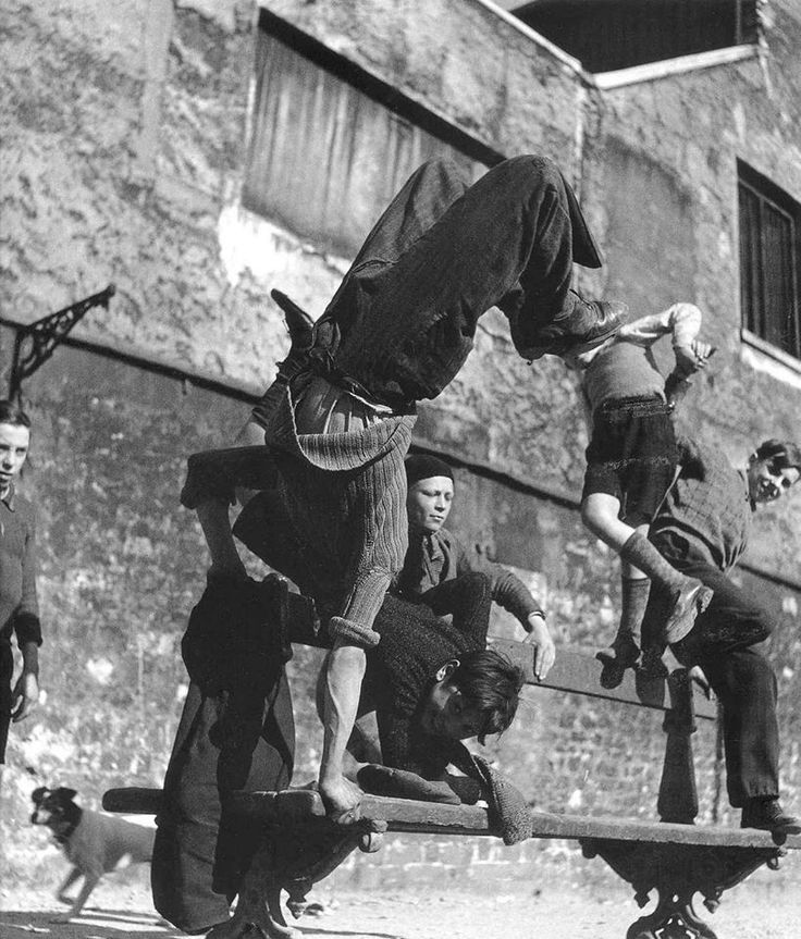 1950s: acrobatic moves on a bench, Paris by Robert Doisneau